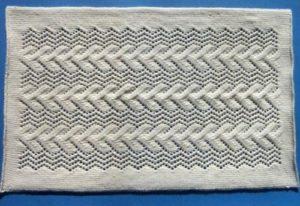Пример изделия из узора спицами